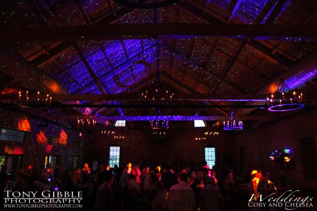 Wedding reception with stars projected on to the ceiling.