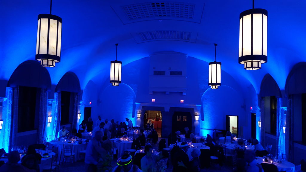 Wedding reception lit with blue uplighting